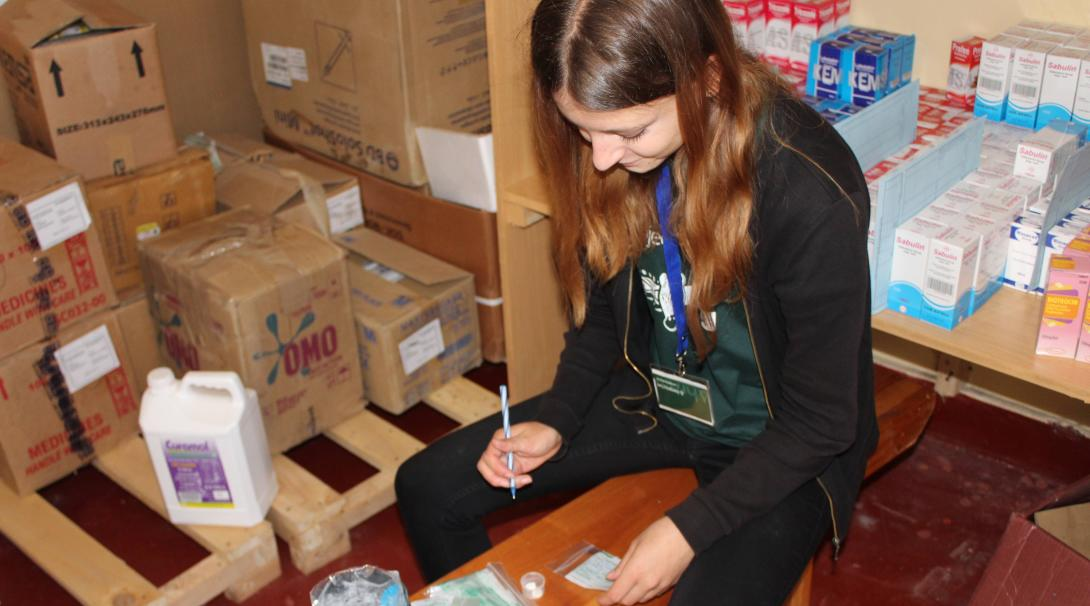 Projects Abroad volunteer classifies medicines in a hospital in Ghana during her pharmacy internship.